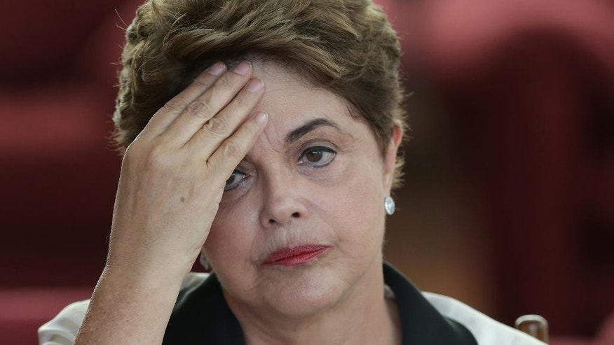 Brazil's ousted President Dilma Rousseff pauses during a press conference at the official residence Alvorada Palace, in Brasilia, Brazil, Friday, Sept. 2, 2016.  Rousseff on Friday slammed the process that led to her ouster this week, promising to provide a strong opposition voice to the new government. In comments to foreign media, Rousseff said next week she would be moving back to her hometown of Porto Alegre in southern Brazil. She has 30 days to vacate the presidential palace. (AP Photo/Eraldo Peres)
