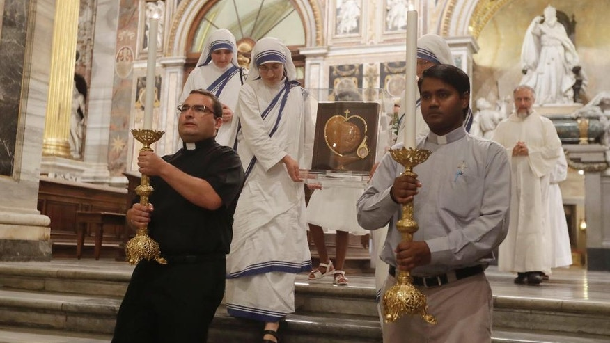 Nuns of Mother Teresa's Missionaries of Charity, carry some of her relics during a vigil of prayer in preparation for the canonization of Mother Teresa in the St. John in Latheran Basilica at the Vatican, Friday, Sept. 2, 2016. (AP Photo/Gregorio Borgia)