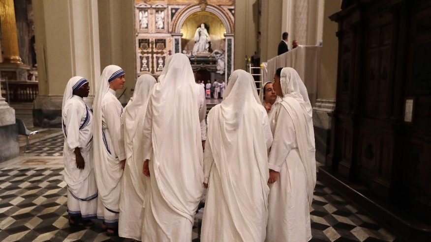 Nuns of Mother Teresa's Missionaries of Charity arrive during a vigil of prayer in preparation for the canonization of Mother Teresa in the St. John in Latheran Basilica at the Vatican, Friday, Sept. 2, 2016. (AP Photo/Gregorio Borgia)
