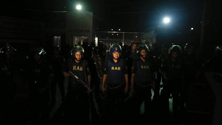 Bangladeshi security personnel stand guard in front of Kashimpur Central Jail where Mir Quashem Ali, a senior leader of the main Islamist party Jamaat-e-Islami, is being held, in Gazipur, on the outskirts of Dhaka, Bangladesh, Saturday, Sept. 3, 2016. Bangladesh's Supreme Court on Tuesday rejected a final appeal by the top Islamist party leader convicted of war crimes in the country's independence war against Pakistan, confirming a death sentence handed down earlier by a special tribunal. (AP Photo)