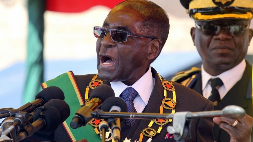 "FILE - In this Monday, Aug. 8, 2016 file photo, Zimbabwean President Robert Mugabe addresses party supporters during a gathering to honor the country's dead heroes, at the National Heroes Acre in Harare. Zimbabwe's 92-year-old President Robert Mugabe arrived home Saturday, Sept. 3, 2016 after an overseas absence that led to rumors about a health crisis, joking to reporters that ""Yes, I was dead."" ""It is true that I was dead,"" the world's oldest head of state said. ""And I resurrected. As I always do."" (AP Photo/Tsvangirayi Mukwazhi, file)"