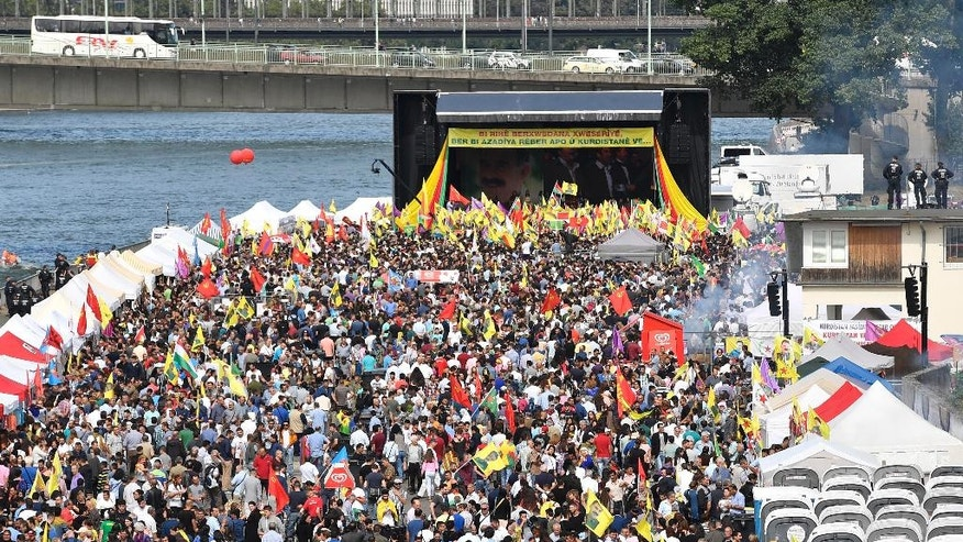 "Thousands of Kurds  demonstrate in Cologne, Germany, Saturday, Sept. 3, 2016. Organizers say Saturday's demonstration is aimed in part at protesting against Turkey's military intervention in northern Syria and what they call the ""dictatorial"" behavior of Turkish President Recep Tayyip Erdogan.  (AP Photo/Martin Meissner"