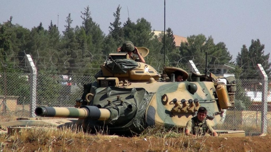 "A Turkish army tank stationed near the Syrian border, in Suruc, Turkey, Saturday, Sept. 3, 2016. Turkey's state-run news agency says Turkish tanks have entered Syria's Cobanbey district northeast of Aleppo in a ""new phase"" of the Euphrates Shield operation. Turkish tanks crossed into Syria Saturday to support Syrian rebels against the Islamic State group, according to the Anadolu news agency. (AP Photo)"