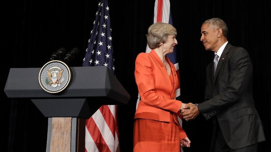U.S. President Barack Obama and British Prime Minister Theresa May shake hands at the conclusion of a news conference after their bilateral meeting in Hangzhou in eastern China's Zhejiang province, Sunday, Sept. 4, 2016, alongside the G20. (AP Photo/Carolyn Kaster)