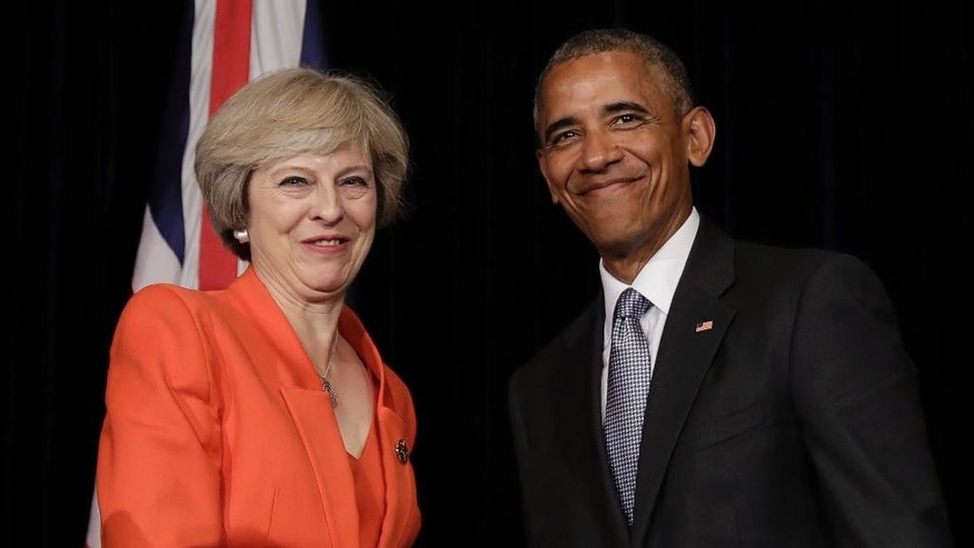 U.S. President Barack Obama and British Prime Minister Theresa May shake hands at the conclusion of a news conference after a bilateral meeting in Hangzhou in eastern China's Zhejiang province, Sunday, Sept. 4, 2016, alongside the G20. (AP Photo/Carolyn Kaster)