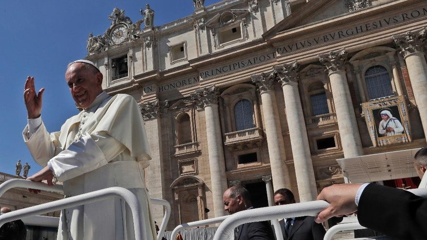 Pope Francis leaves St. Peter's Square at the Vatican at the end of a jubilee audience for workers and volunteers of mercy led by Pope Francis, Saturday, Sept. 3, 2016. The square hosts a ceremony Sunday expected to draw hundreds of thousands of admirers of Mother Teresa, a nun who before her death in 1997, cared for the destitute who were dying in the streets of India. (AP Photo/Alessandra Tarantino)