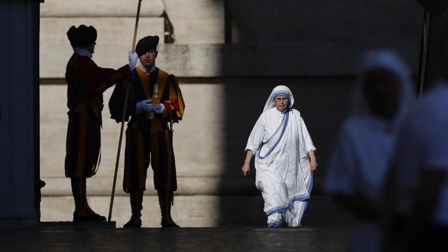A Missionaries of Charity nun arrives in St. Peter's Square at the Vatican to attend a jubilee audience for workers and volunteers of mercy, Saturday, Sept. 3, 2016. The square hosts a ceremony Sunday expected to draw hundreds of thousands of admirers of Mother Teresa, a nun who before her death in 1997, cared for the destitute who were dying in the streets of India. (AP Photo/Alessandra Tarantino)