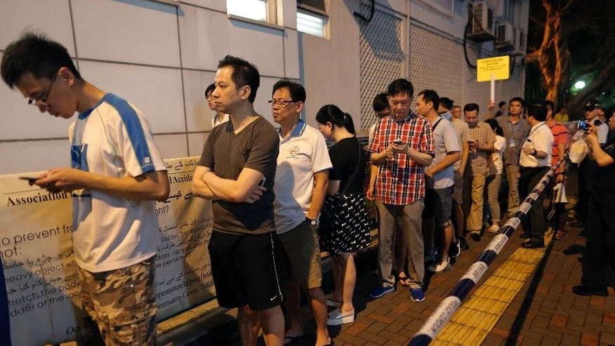 People queue at a polling station to vote for the legislative council election, Sunday, Sept. 4, 2016. Polls opened in Hong Kong Sunday for the specially administered Chinese city's most crucial election since the handover from Britain in 1997. The vote for lawmakers in the Legislative Council is also the first since 2014 pro-democracy street protests rocked the Asian financial hub. AP Photo/Vincent Yu)