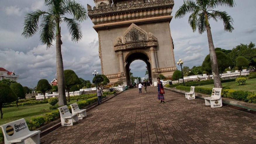 A man takes a picture of himself standing in front of Patuxary Victory Gate in Vientiane, Laos, Sunday, Sept. 4, 2016. The coming week will see a series of meetings of the member countries of the Association of Southeast Asian Nations and their key dialogue partners scheduled to begin in Vientiane on September 6, 2016.(AP Photo/ Gemunu Amarasinghe)