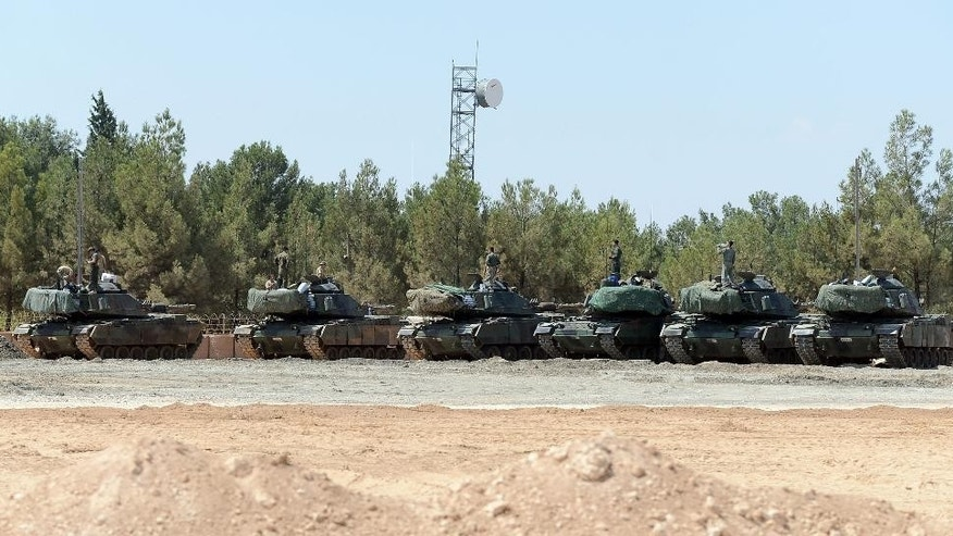 Turkish tanks stationed near the Syrian border, in Karkamis, Turkey.