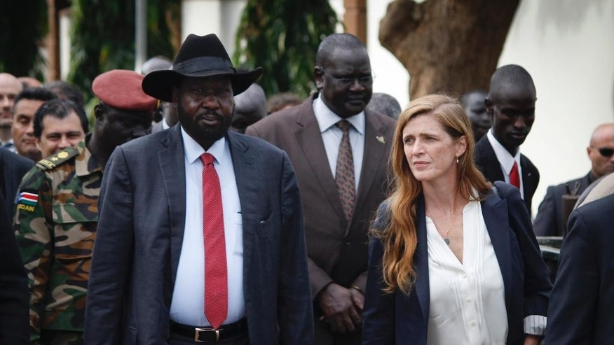 South Sudan's President Salva Kiir, left, walks with U.S. Ambassador to the United Nations Samantha Power, right, and other visiting members of the UN Security Council in the capital Juba, South Sudan, Sunday, Sept. 4, 2016. South Sudan has agreed to the deployment of a 4,000-strong regional protection force approved by the U.N. Security Council after first rejecting the peacekeepers as a violation of its sovereignty. (AP Photo/Justin Lynch)