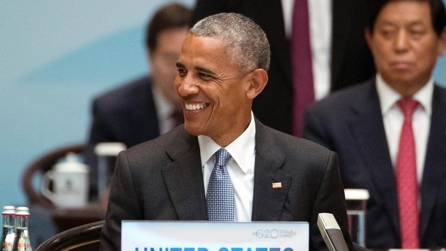 U.S. President Barack Obama smiles during the opening ceremony of the G20 Summit in Hangzhou in eastern China's Zhejiang province, Sunday, Sept. 4, 2016. (AP Photo/Mark Schiefelbein, Pool)