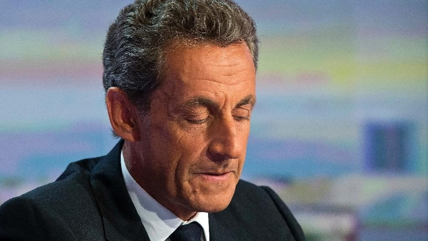 FILE - In this Aug. 24, 2016. file photo, former French President Nicolas Sarkozy, closes his eyes prior to a televised interview in Boulogne-Billancourt, outside Paris. A Paris prosecutor has requested Monday Sept.5, 2016 a criminal trial for former President Nicolas Sarkozy over suspected illegal overspending on his failed 2012 re-election campaign. (AP Photo/Michel Euler, File)
