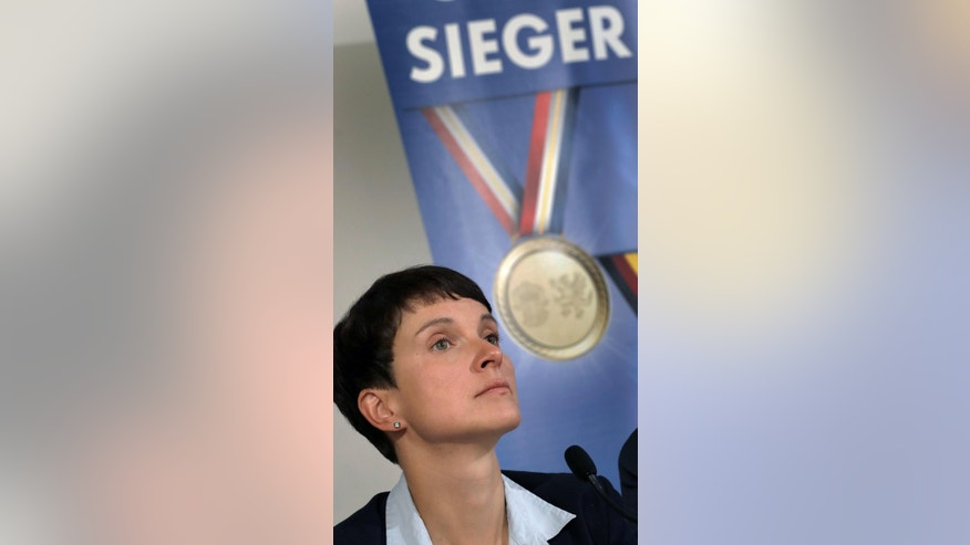 "Frauke Petry, chairwoman of the German right-populist AfD (Alternative for Germany) party, attends a press conference  about yesterday's elections in Mecklenburg-Western Pomerania, in Berlin, Germany, Monday, Sept. 5, 2016. Word in the background reads 'winner' and is part of the slogan : ""That's How Winners Look Like""  The nationalist, anti-immigration party performed strongly in a state election Sunday in the region where German Chancellor Angela Merkel has her political base, overtaking her conservatives to take second place amid discontent with her migrant policies. (AP Photo/Michael Sohn)"