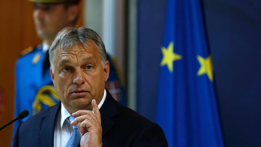Hungary's Prime Minister Viktor Orban gestures during a press conference after talks with his Serbian counterpart Aleksandar Vucic in Belgrade, Serbia, Monday, Sept. 5, 2016. Orban arrived on a one-day visit to Serbia. (AP Photo/Darko Vojinovic)