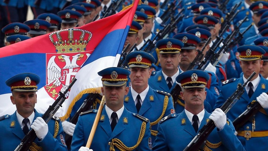 Members of the Serbian honor guard prepare for the welcoming ceremony for Hungary's Prime Minister Viktor Orban in Belgrade, Serbia, Monday, Sept. 5, 2016. Orban arrived on a one-day visit to Serbia. (AP Photo/Darko Vojinovic)