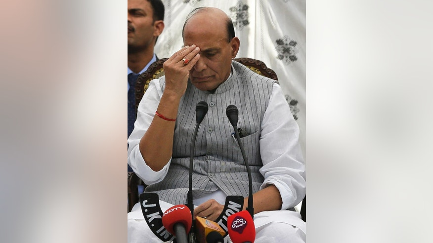 Indian Home Minister Rajnath Singh holds a press conference in Srinagar, Indian controlled Kashmir, Monday, Sept. 5, 2016. Singh is heading an all-party delegation to hold talks to various cross sections of people and leaders in Kashmir to find a peaceful solution to the ongoing unrest in the valley. (AP Photo/Mukhtar Khan)