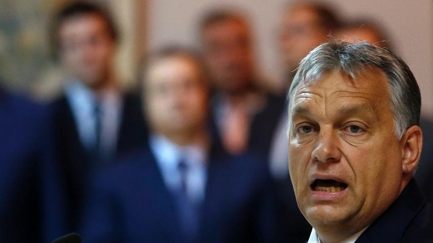 Hungary's Prime Minister Viktor Orban speaks during a press conference after talks with his Serbian counterpart Aleksandar Vucic in Belgrade, Serbia, Monday, Sept. 5, 2016. Orban arrived on a one-day visit to Serbia. (AP Photo/Darko Vojinovic)