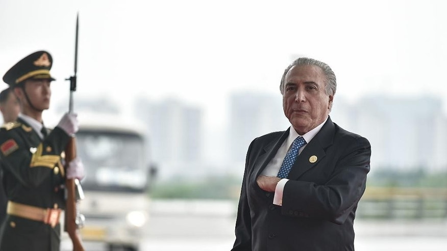 Brazilian acting President Michel Temer arrives at the Hangzhou Exhibition Center to participate in G20 Summit, Sunday, Sept. 4, 2016 in Hangzhou, China. (Etienne Oliveau/Pool Photo via AP)