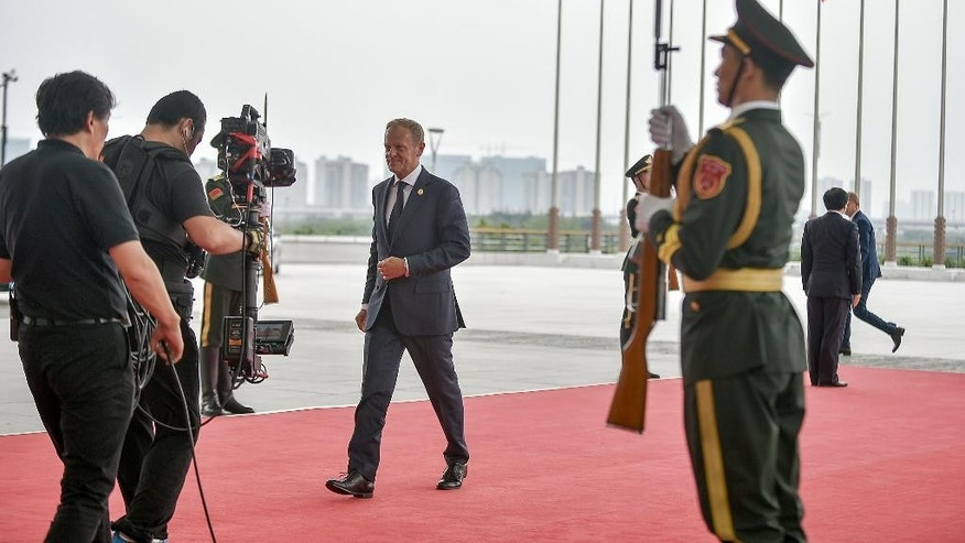 President Donald Tusk of the European Council arrives at the Hangzhou Exhibition Center to participate in G20 Summit, Sunday, Sept. 4, 2016 in Hangzhou, China. (Etienne Oliveau/Pool Photo via AP)