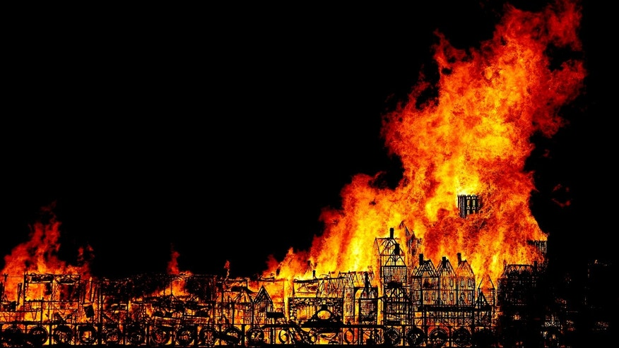A nearly 400-foot-long model was set on fire in London during a retelling of the story of the Great Fire of London.