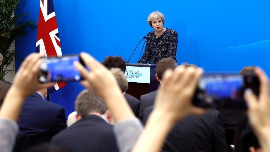 British Prime Minister Theresa May speaks at a press conference held at the end of the G-20 summit in Hangzhou in eastern China's Zhejiang province, Monday, Sept. 5, 2016. (AP Photo/Ng Han Guan)