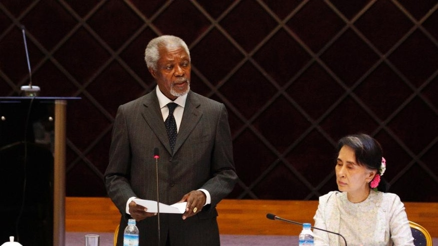 Former U.N. Secretary-General Kofi Annan speaks as Myanmar Foreign Minister Aung San Suu Kyi, left, listens during a meeting with members of the National Reconciliation and Peace Center (NRPC) Monday, Sept. 5, 2016, in Yangon, Myanmar. (AP Photo/Thein Zaw)