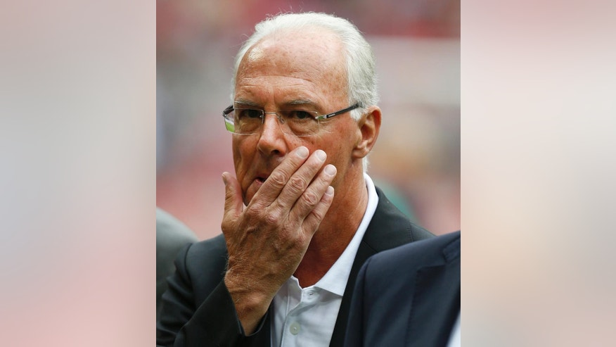 FILE - In this July 14, 2013, file photo, soccer legend Franz Beckenbaueris shown prior to a friendly soccer match between FC Bayern Munich and FC Barcelona in the Allianz Arena stadium in Munich, southern Germany. A German newspaper says former soccer great Franz Beckenbauer has had open-heart surgery and received at least one bypass. Beckenbauer's management team has not responded to a request for comment on his health following a report in the mass-circulation Bild newspaper. Bild said the surgery took place Saturday Sept. 3, 2016  and had been planned for several weeks.  (AP Photo/Matthias Schrader, file)