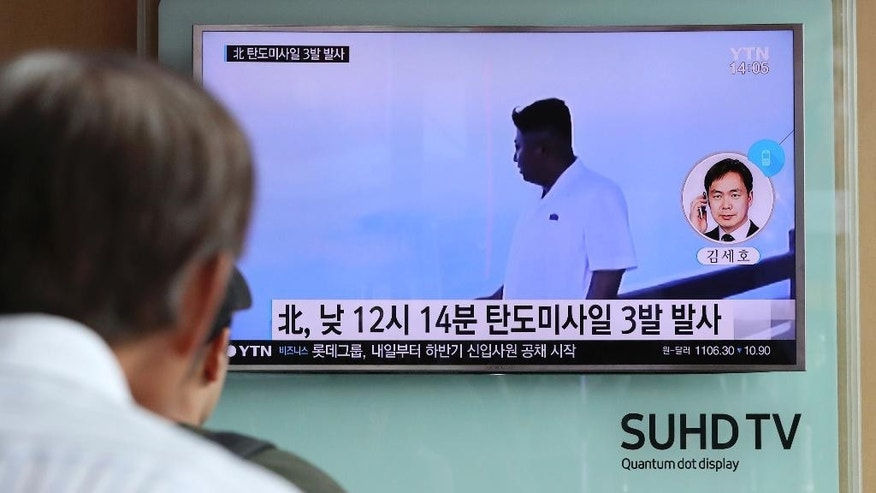 "A man watches a TV news program showing a file image of North Korean leader Kim Jong Un while reporting about the North's missile launch, at the Seoul Train Station in Seoul, South Korea, Monday, Sept. 5, 2016. North Korea fired three ballistic missiles off its east coast Monday, South Korea's military said, in a show of force timed to the G-20 economic summit in China. The letters on the screen read: ""North Korea fired three ballistic missiles."" (AP Photo/Lee Jin-man)"