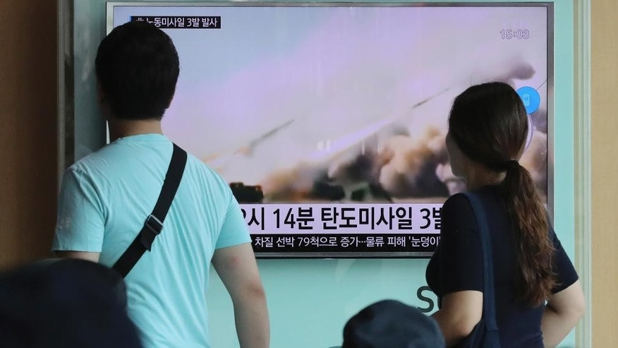 "People watch a TV news program reporting about North Korea's missile launch, at the Seoul Train Station in Seoul, South Korea, Monday, Sept. 5, 2016. North Korea fired three ballistic missiles off its east coast Monday, South Korea's military said, in a show of force timed to the G-20 economic summit in China. The letters on the screen read: ""North Korea fired three ballistic missiles."" (AP Photo/Lee Jin-man)"