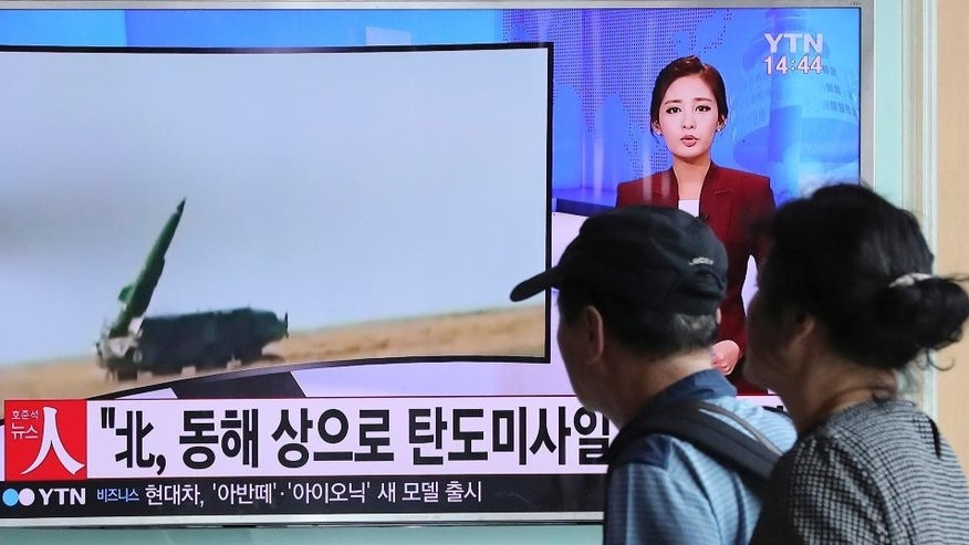 "People watch a TV news program reporting about North Korea's missile launch, at the Seoul Train Station in Seoul, South Korea, Monday, Sept. 5, 2016. North Korea fired three ballistic missiles off its east coast Monday, South Korea's military said, in a show of force timed to the G-20 economic summit in China. The letters on the screen read: ""North Korea, ballistic missiles to east coast."" (AP Photo/Lee Jin-man)"