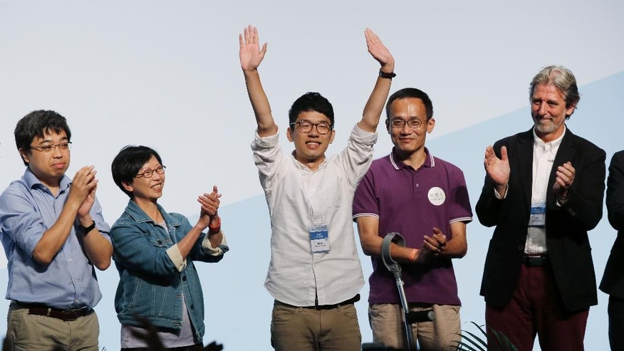 Student Nathan Law, center, who helped lead the 2014 protests, celebrates after winning a seat at the legislative council elections in Hong Kong, Monday, Sept. 5, 2016. A new wave of anti-China activists appeared headed for victory in Hong Kong's most pivotal elections since the handover from Britain in 1997, which could set the stage for a fresh round of political confrontations over Beijing's control of the city. (AP Photo/Kin Cheung)
