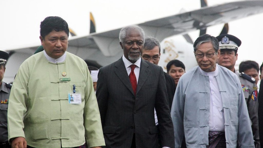 Former United Nations Secretary-General Kofi Annan, center, who chairs the recently created Rakhine State Advisory Commission, is escorted by local authorities as he arrvies arrives at the airport in Sittwe, Rakhine state, Myanmar. More than 1,000 Buddhists in Sittwe wracked by religious and ethnic strife protested Tuesday's arrival of Annan, saying the Ghanaian is meddling in the country's affairs by leading a government-appointed commission to find solutions to the conflict. (AP Photo/Esther Htusan)