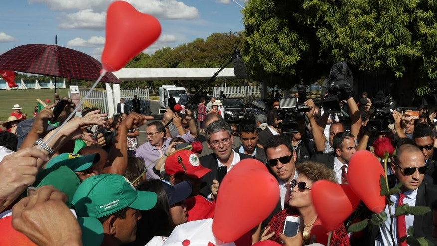 Brazil's impeached President Dilma Rousseff, second from right wearing sunglasses, blows kisses to supporters as she leaves the presidential residence, Alvorada Palace, in Brasilia, Brazil, Tuesday, Sept. 6, 2016. Rousseff, who has vowed to form a strong opposition against interim President Michel Temer, who was once her vice president, is appealing her impeachment to the Supreme Court. Legal experts say her appeal is unlikely to succeed as several appeals during the months-long impeachment process were rejected. (AP Photo/Eraldo Peres)