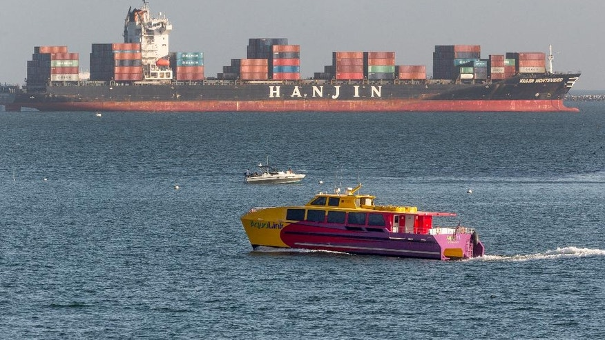 FILE -  In this Sept. 1, 2016, file photo, South Korea's Hanjin Shipping Co. container ship Hanjin Montevideo, top, is anchored outside the Port of Long Beach in Long Beach, Calif. South Korea's financial regulator said Monday, Sept. 5, 2016, that financially troubled Hanjin Shipping Co. will seek stay orders in dozens of countries this week to help minimize disruptions caused by its slide into bankruptcy proceedings. The Financial Services Commission said Hanjin, the country's largest ocean container shipper, will seek bankruptcy protection in 43 countries, including Canada, Germany and Britain. (AP Photo/Damian Dovarganes, File)