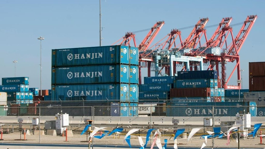 FILE - In this Sept. 1, 2016, file photo, South Korea's Hanjin Shipping Co. containers are seen in the Port of Long Beach, Calif. South Korea's financial regulator said Monday, Sept. 5, 2016, that financially troubled Hanjin Shipping Co. will seek stay orders in dozens of countries this week to help minimize disruptions caused by its slide into bankruptcy proceedings. The Financial Services Commission said Hanjin, the country's largest ocean container shipper, will seek bankruptcy protection in 43 countries, including Canada, Germany and Britain. (AP Photo/Damian Dovarganes, File)