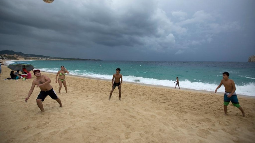 People play on El Medano Beach before the arrival of Hurricane Newton in Cabo San Lucas, Mexico, Monday Sept. 5, 2016. Authorities at the southern end of Mexico's Baja California peninsula ordered schools closed and set up emergency shelters as Hurricane Newton gained strength while bearing down on the twin resorts of Los Cabos for a predicted arrival Tuesday morning. (AP Photo/Eduardo Verdugo)