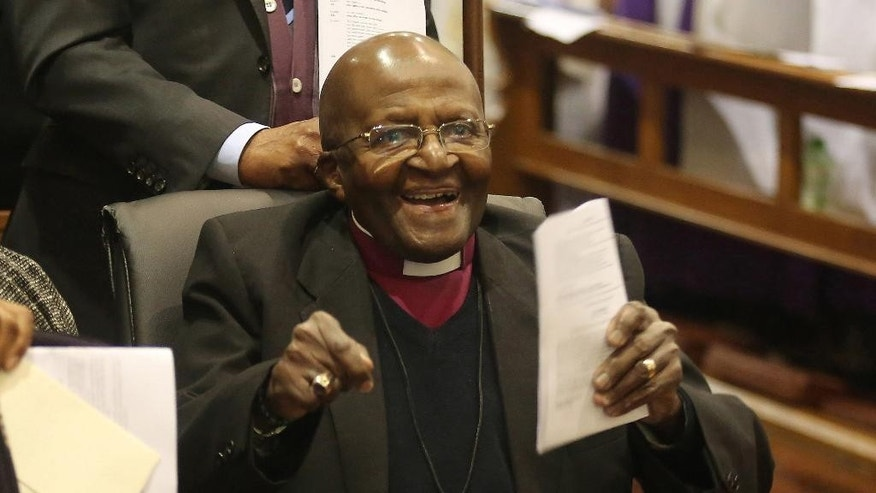 FILE -- In this July 10, 2016 file photo Anglican Archbishop Emeritus Desmond Tutu as he take part in a Mass as he celebrates four decades of episcopal ministry at a special thanksgiving Mass at St Mary's Cathedral in Johannesburg, The family of Tutu says he is responding well to treatment for an infection after checking into hospital two weeks ago. (AP Photo/Denis Farrell-File)