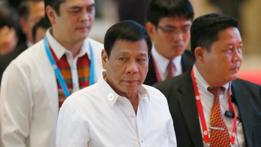 Philippine President Rodrigo Duterte, center, arrives at the National Convention Center for scheduled bilateral meetings with ASEAN leaders on the sidelines of the 28th and 29th ASEAN Summits and other related summits Tuesday, Sept. 6, 2016 in Vientiane, Laos. (AP Photo/Bullit Marquez)