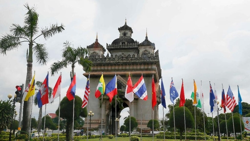 Flags of the 10-member ASEAN (Association of Southeast Asian Nations) and its dialogue partners are placed around the Patuxay Monument in downtown Vientiane, Laos, Monday, Sept. 5, 2016. Laos is this year's host of the 28th and 29th ASEAN Summits and related summits that include the United States, Canada, Russia, China, Japan, Korea, Australia, New Zealand and India. (AP Photo/Bullit Marquez)