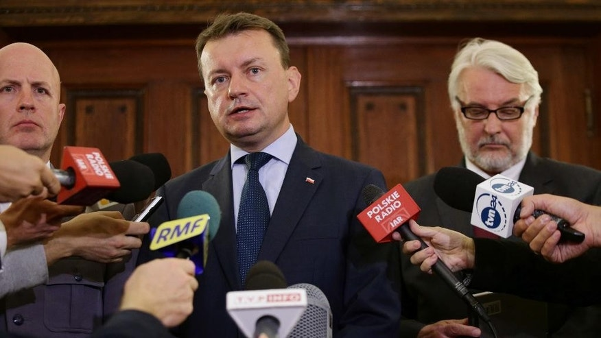 "Poland's Foreign Minister Witold Waszczykowski, right, and Home Affairs Minister, Mariusz Blaszczak, centre, speaking to media during a press conference at the Polish Embassy in London, Monday Sept. 5, 2016. The ministers arrived in Britain Monday for talks about the security of hundreds of thousands of Poles there, following two recent attacks that left one Pole dead and three others injured. Waszczykowski called the trip ""an urgent visit,"" and said he believed that less protection was being offered to Poles in Britain than to other nationals. (PA via AP)"