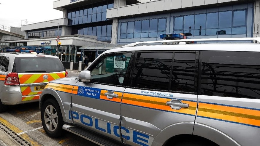 Police cars parked outside London City Airport, Tuesday, Sept. 6, 2016. All flights in and out of London City Airport were disrupted on Tuesday after demonstrators blocked a runway to protest expansion plans.The protest ended after police arrested nine people on suspicion of aggravated trespass. (AP Photo/Kirsty Wigglesworth)