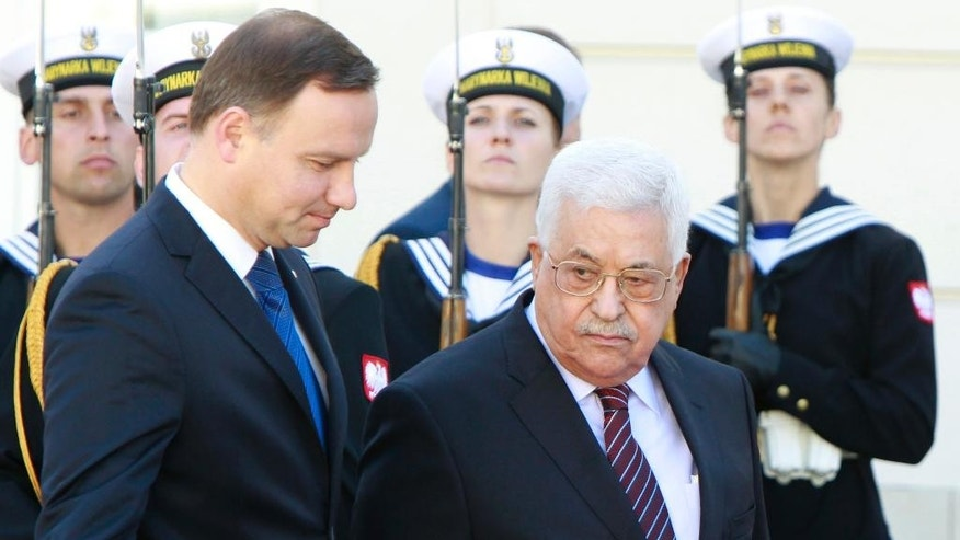 Polish President Andrzej Duda, left, and Palestinian President Mahmoud Abbas inspect the honor guard during an official welcoming ceremony in the courtyard of the presidential palace in Warsaw, Poland, Tuesday, Sept. 6, 2016. (AP Photo/Czarek Sokolowski)