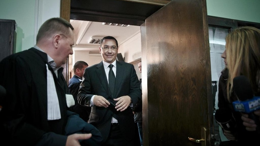FILE -  This is a  Friday, Nov. 6, 2015, file picture  of Romania's outgoing prime minister Victor Ponta as he exits after an appearance at the High Court for Cassation and Justice, in Bucharest. Romanian anti-corruption prosecutors said Tuesday Sept. 6, 2016 that former Prime Minister Victor Ponta is being investigated for alleged financial improprieties connected to another political figure's 2012 visit to Bucharest. Prosecutors did not identify the prominent visitor, but a businessman who was questioned in the probe identified him as former British Prime Minister Tony Blair. (AP Photo/Vadim Ghirda, File)