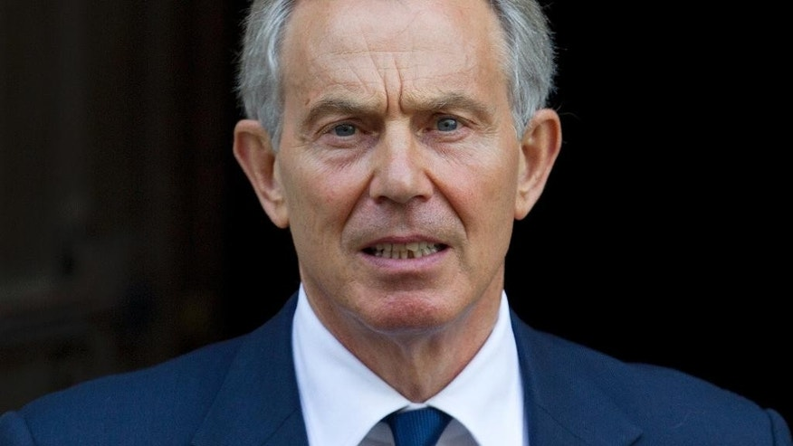 FILE - This is a Monday, May 28, 2012 file picture, of former British Prime Minister Tony Blair leaves the High Court in London. Romanian anti-corruption prosecutors said Tuesday Sept. 6, 2016 that former Prime Minister Victor Ponta is being investigated for alleged financial improprieties connected to another political figure's 2012 visit to Bucharest. Prosecutors did not identify the prominent visitor, but a businessman who was questioned in the probe identified him as former British Prime Minister Tony Blair. (AP Photo/Alastair Grant, File)