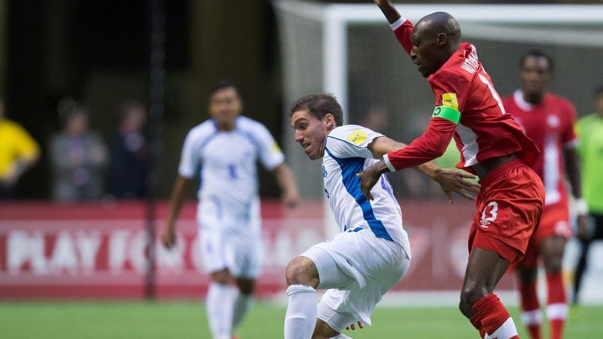 El Salvador's Pablo Punyed, left, and Canada's Atiba Hutchinson vie for the ball during the first half of a CONCACAF World Cup soccer qualifying match Tuesday, Sept. 6, 2016, in Vancouver, British Columbia. (Darryl Dyck/The Canadian Press via AP)