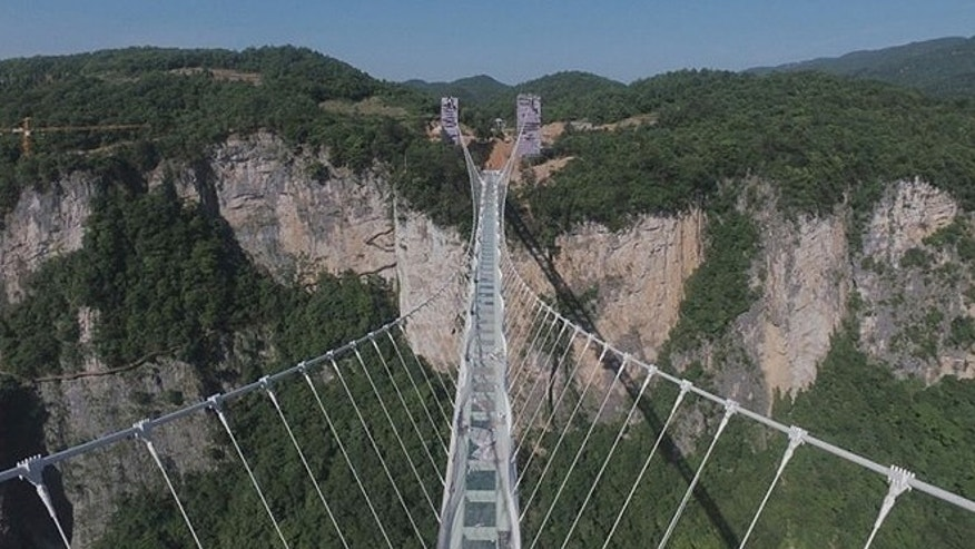 The world's longest and highest glass bottom bridge above the Zhangjiajie Grand Canyon, in the central Hunan province, was shut down after tens of thousands of tourists traversed the span every day.
