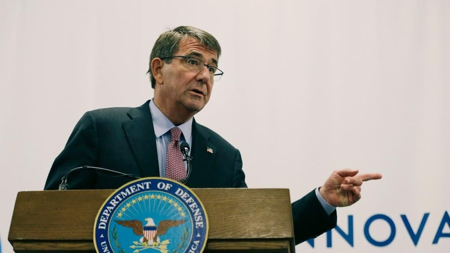 "FILE - In this July 26, 2016 file photo, Defense Secretary Ash Carter speaks during a news conference in Cambridge, Mass. Carter is strongly criticizing Russia for what he says is Moscow's ""clear ambition to erode the principled international order"" through coercion and aggression. Carter used a speech Wednesday, Sept. 7, 2016, to students at Oxford University to blast what he calls Russia's ""unprofessional behavior"" in Ukraine, Syria and cyberspace. He's accusing Moscow of nuclear ""saber rattling."" (AP Photo/Elise Amendola, File)"