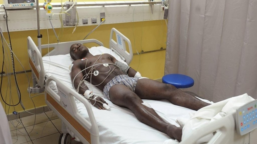 A supporter of Gabon president Ali Bongo Ondimba receives treatment at a hospital after being attacked by opposition supporters in Libreville, Gabon, Tuesday, Sept. 6, 2016, The European Union observation mission in Gabon said Tuesday it noted an anomaly in voting results from the president's stronghold province that pushed him over the edge to win re-election by a slim margin.( AP Photo)