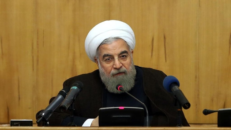 "In this photo released by official website of the office of the Iranian Presidency, Iranian President Hassan Rouhani speaks at a weekly cabinet meeting in Tehran, Iran, Wednesday, Sept. 7, 2016. Iran's President Hassan Rouhani says Islamic countries should take ""punitive"" measures against Saudi Arabia following the deaths of over two thousand pilgrims in a crush of crowds during last year's hajj. The official IRNA news agency quotes Rouhani as saying the pilgrims lost their lives because of the ""lack of qualification"" of Saudi authorities. (Iranian Presidency Office via AP)"
